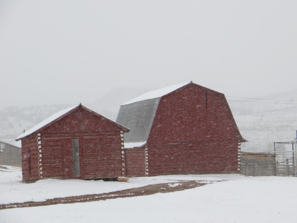 red barn in snowstorm